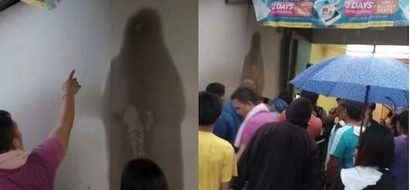 Miracle or creepy? People are worshiping this black figure on the wall that looks like Mama Mary