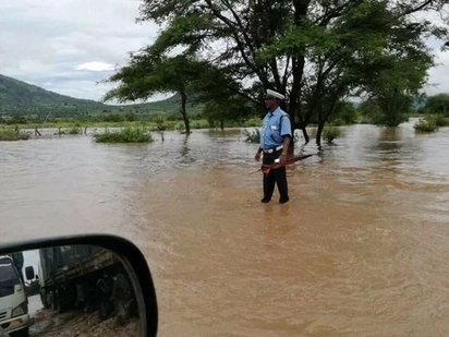 Cop seen directing traffic on heavily flooded road humbles his bosses