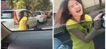 Beautiful girl spotted dancing right in the traffic jam