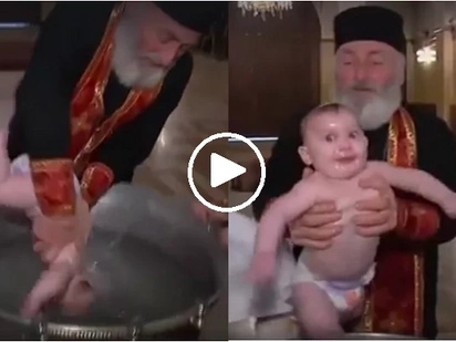Ang tinding binyag naman nito! Video of babies being baptized in Georgia will make your head spin