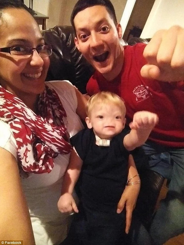 Eli with his parents. He was famous for his fist bumps and cheerful personality