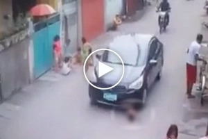 Shocking incident of 3-year-old brutally crushed under tire of sedan when he crossed the street caught on CCTV