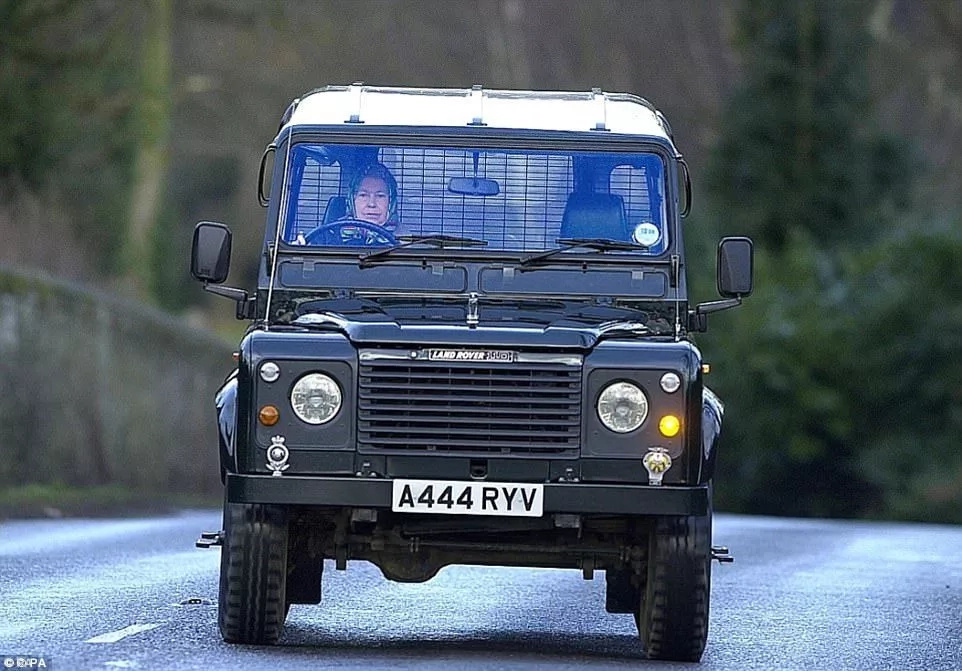 The Queen seen driving a Land Rover in 2000