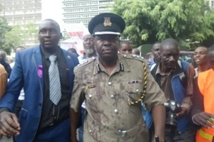 Police spokesman Charles Owino loses his cool on live TV, almost clobbers activist (video)