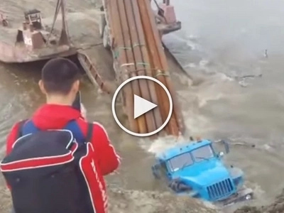 Russian driver does it all to make his truck vanish under water in one second