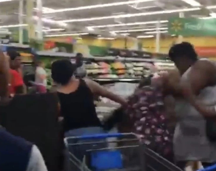 Two women brake into a fight over the last crate of water before hurricane Matthew hits
