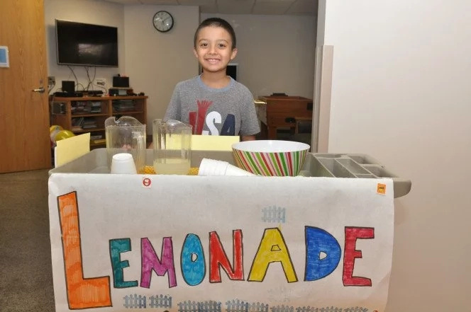 Boy, 8, pushes lemonade cart to help him recover from life-threatening brain surgery