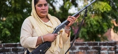Armed and ready: Indian woman takes to the streets the gun to get justice for rape victims