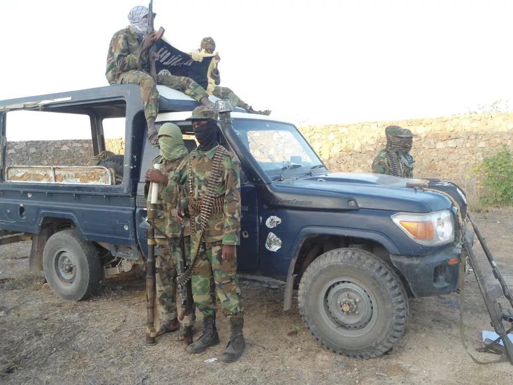 Al-Shabaab terror group poses with captured Kenyan vehicle