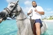 Fat? Not me! DJ Khaled denies claims he was so overweight he broke a horse's back