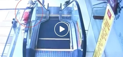 Frightening video of 2-year old falling from escalator in Chinese mall