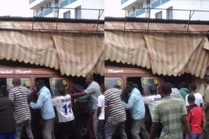 DEATH as matatu crashes into shops (photos)
