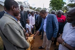Uhuru Kenyatta goes to Nandi, launches electricity in a grass-thatched house then he is given this to drink (photos)