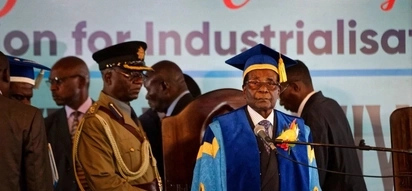 Robert Mugabe attends graduation ceremony despite military coup