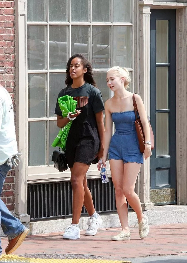 Malia with a friend on her way to pick her laundry. Photo: Daily Mail