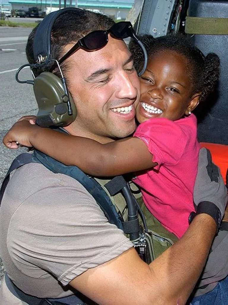 Man saved a tiny girl from hurricane, she follows in his footsteps