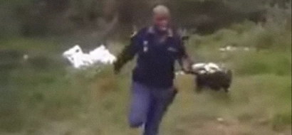 Policeman screams and runs like a little girl when his dog shows him a snake