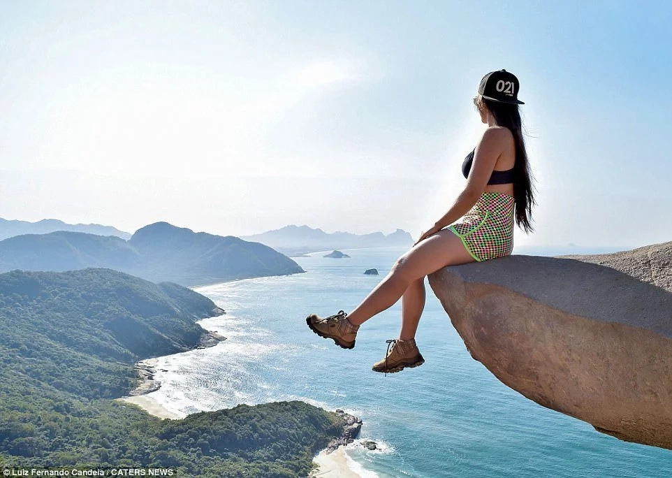 She even sits on the edge of the cliff. Photo: Caters News