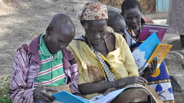 She is pictured here with her fellow learners at their adult literacy class. Photo: BBC