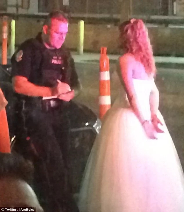 The bride being arrested. Photo: Twitter/IAmByks