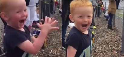This little kid's ecstatic reaction to a motorcycle race is incredible