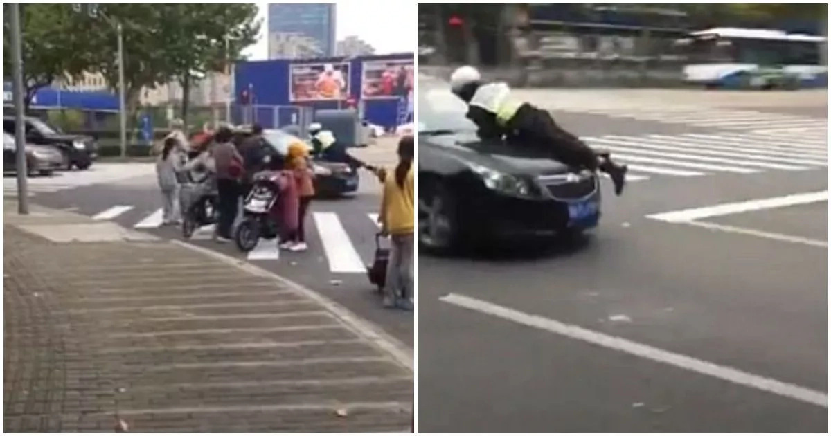 The driver attempted to drive off but the policeman wouldn't let him. Photo: Asia Wire