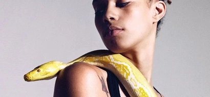 She loved large python snake pet and let it rest on her back. The end of the story is unexpected!