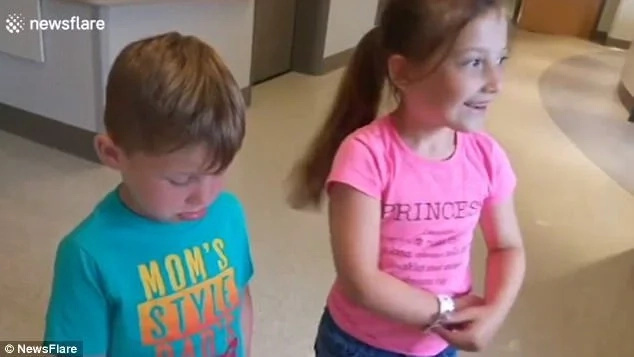 The boy is disappointed while the girl is delighted. Photo: Newsflare