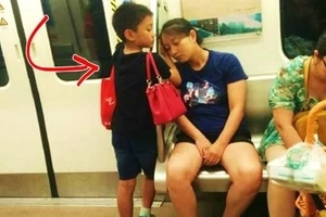 This boy went viral for being affectionate to his mother. He let his mom use his hand as a pillow while she slept during a train ride!