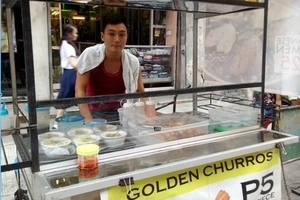 Netizens go crazy over handsome Japanese vendor and his 'golden churros' in Caloocan