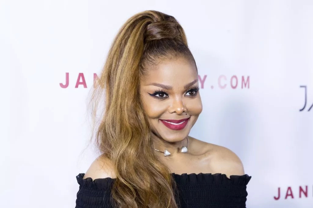 Janet Jackson flaunts her slim figure in a tight strapless dress after a 70-pound weight loss