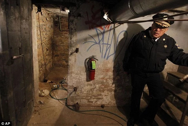 When the police got down the basement, they immediately handcuffed this woman