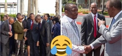 Uhuru holds lady on shoulders as Sonko snaps the moment (photo)