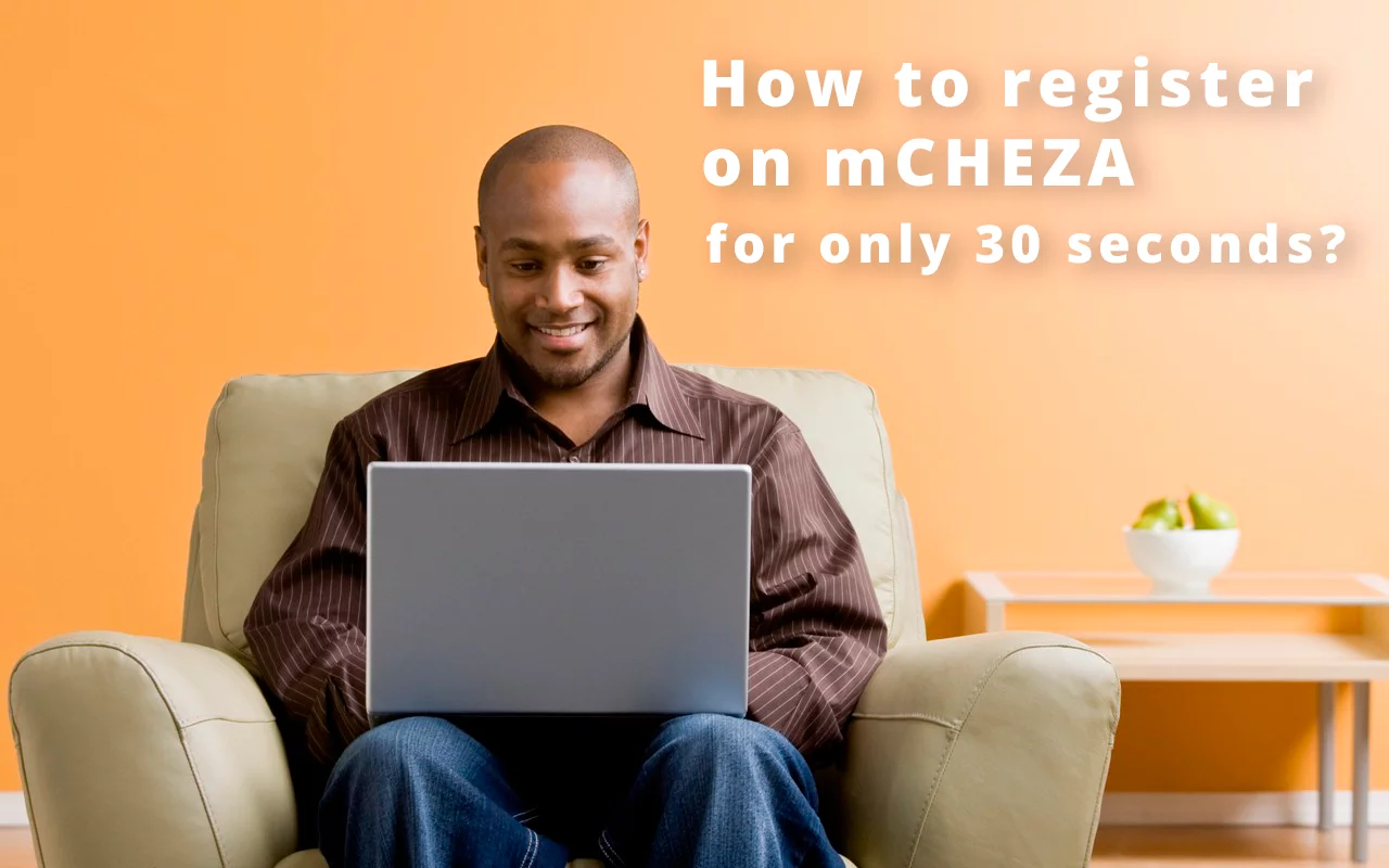 A man with a laptop getting registered on mCHEZA