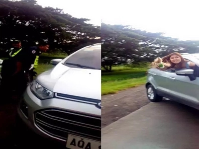 Ay attitude problem si ate! Pinay motorist throws drinks to security personnel after being denied entry