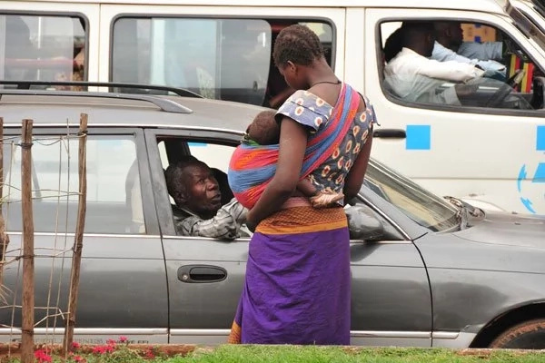 Poor woman, 25, forced to beg on streets of Uganda so as to buy pads