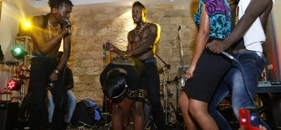 Embarrassing!Cute lady begs for passionate kiss from Sauti Sol member, gets rejected (Photos)