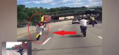 Rider spotted performing dangerous tricks using motorcycle in the middle of a busy road...breathtaking!