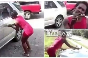 It's over 'beb'! Woman goes completely berserk, smashes ex-lover's car with hammer in REVENGE