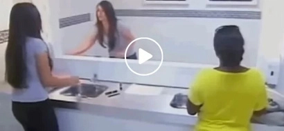Unsuspecting woman gets frightened by mirror prank