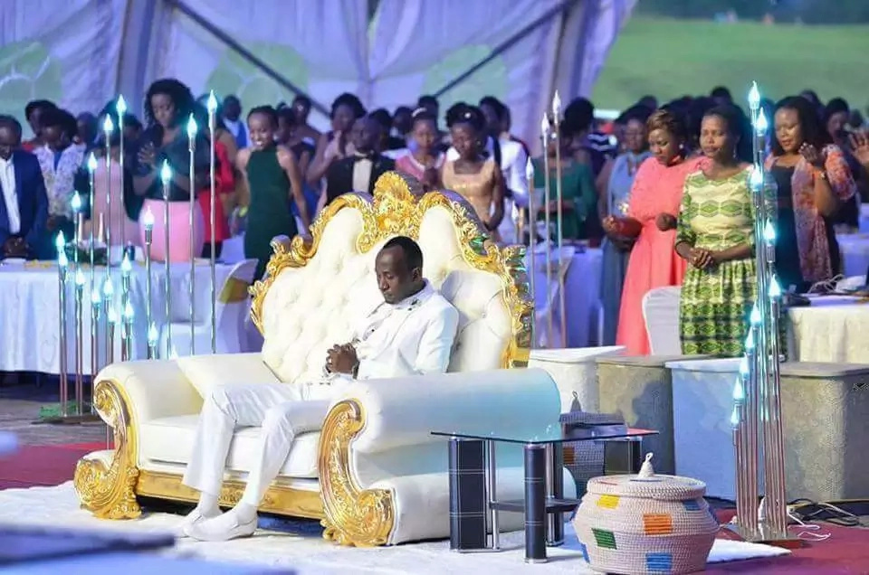 Flamboyant pastor whose congregants worship him by kissing his feet (photos)