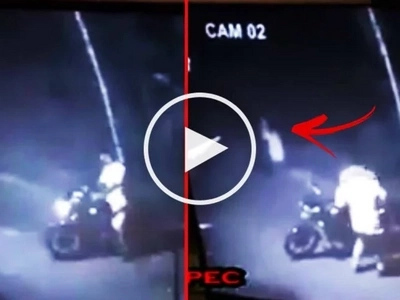 This motorcycle rider encountered a 'White Lady' on the side of the road. Watch the terrifying CCTV footage here!