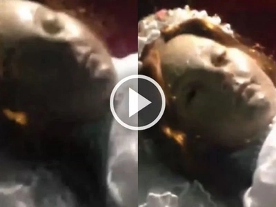 Spine-chilling moment a child saint that was dead for 300 years opens her eyes