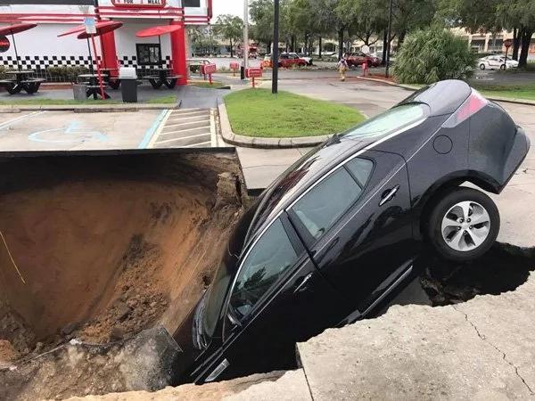 Elderly couple falls into a sinkhole