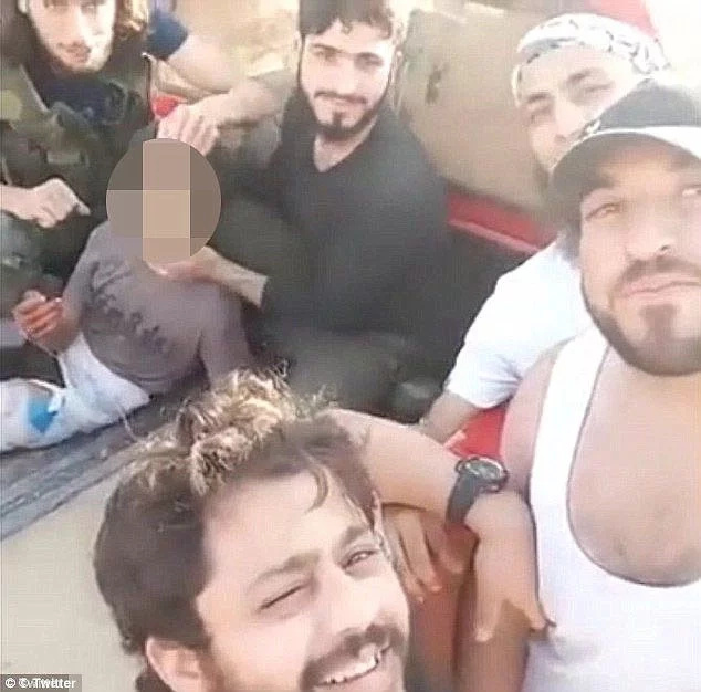 US-backed Syrian rebels behead boy believed to be a spy
