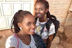 Somber mood as sisters who died in Kisii accident are laid to rest (photos)