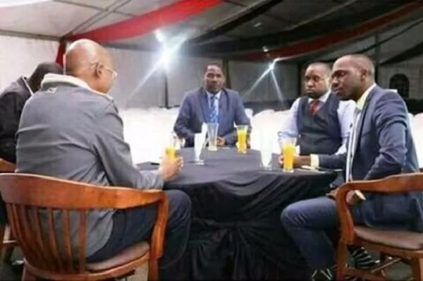 Governor Munya 'finishes' his juice before Larry Madowo and other guests start