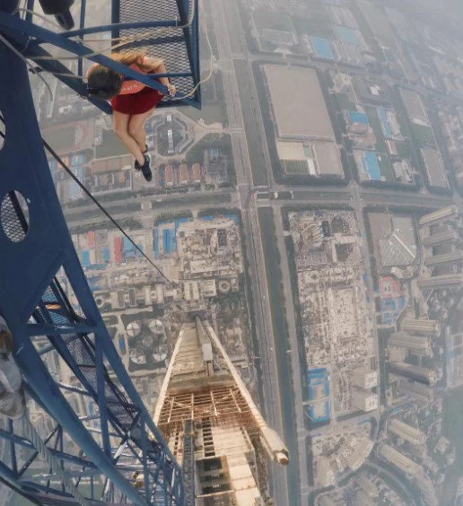 Watch this russian couple climb the tallest crane in the world!