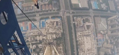 Watch this couple climb the tallest crane in the world in this vertigo-inducing video!