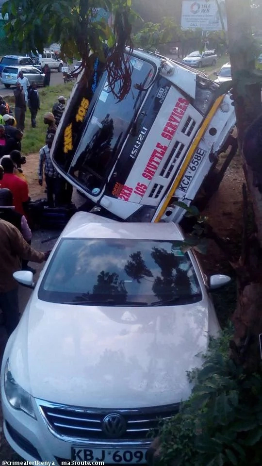 Matatu falls on private car while overlapping